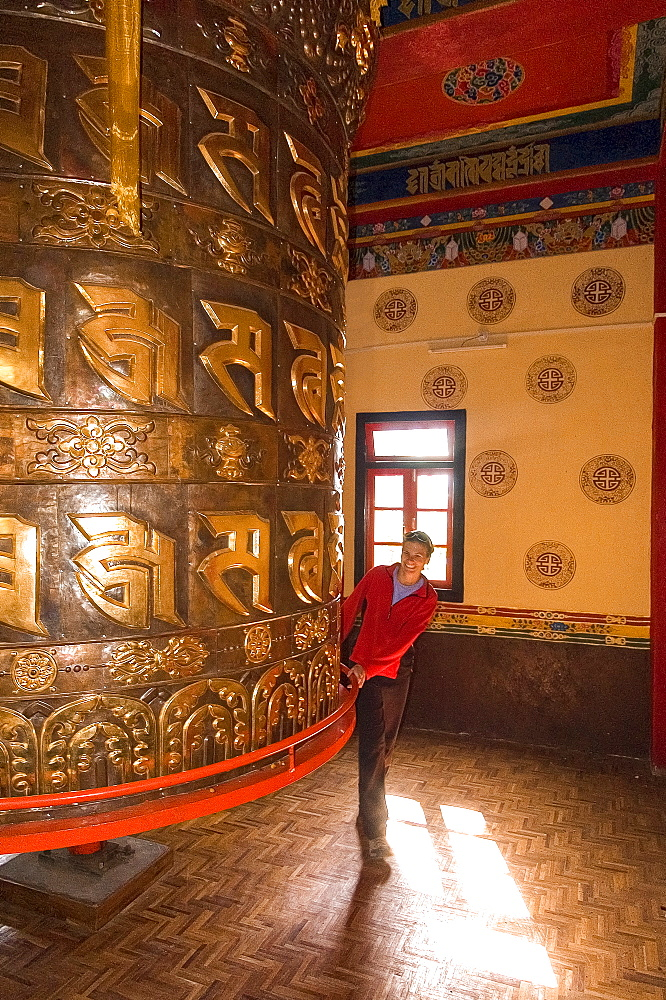 Happy Man Spinning A Giant Prayer Wheel At Tashiding Monastery, Sikkim, India