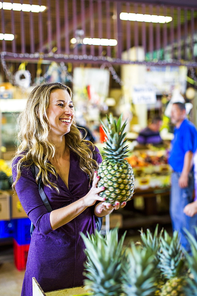 A Young Woman Buying Pineapple At A Market In Old San Juan, Puerto Rico