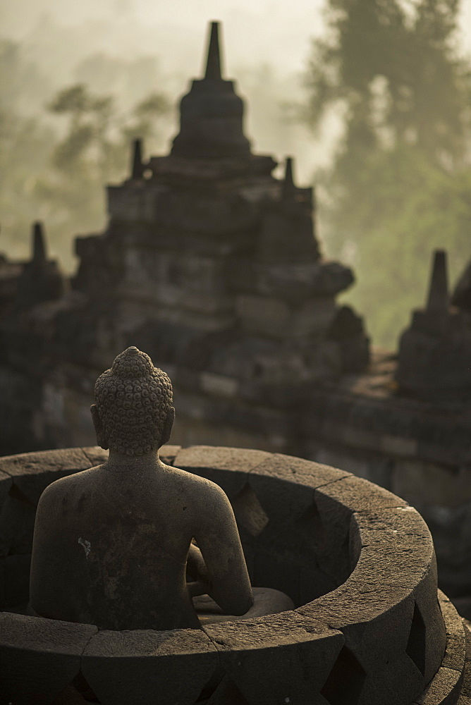 View Of Buddha Statue At The Borobudur Temple In Java, Indonesia