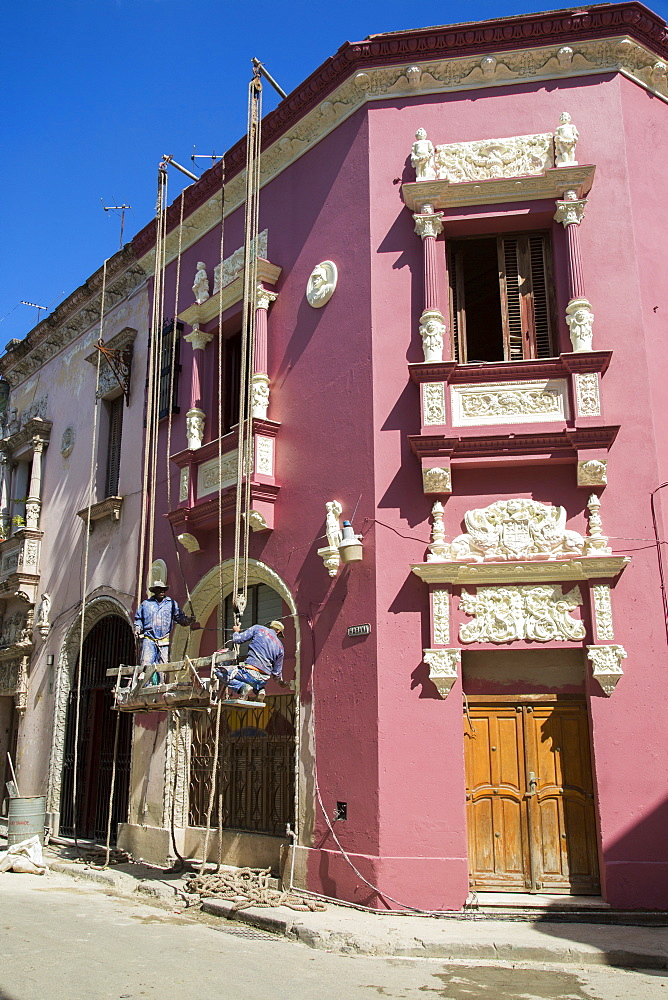 Workers On Rope Re-painting A Typical Classical Style Building In Habana Vieja, Old Havana, Cuba