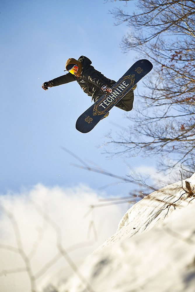 A snowboarder doing a method on a side hit at Mount Snow, VT.