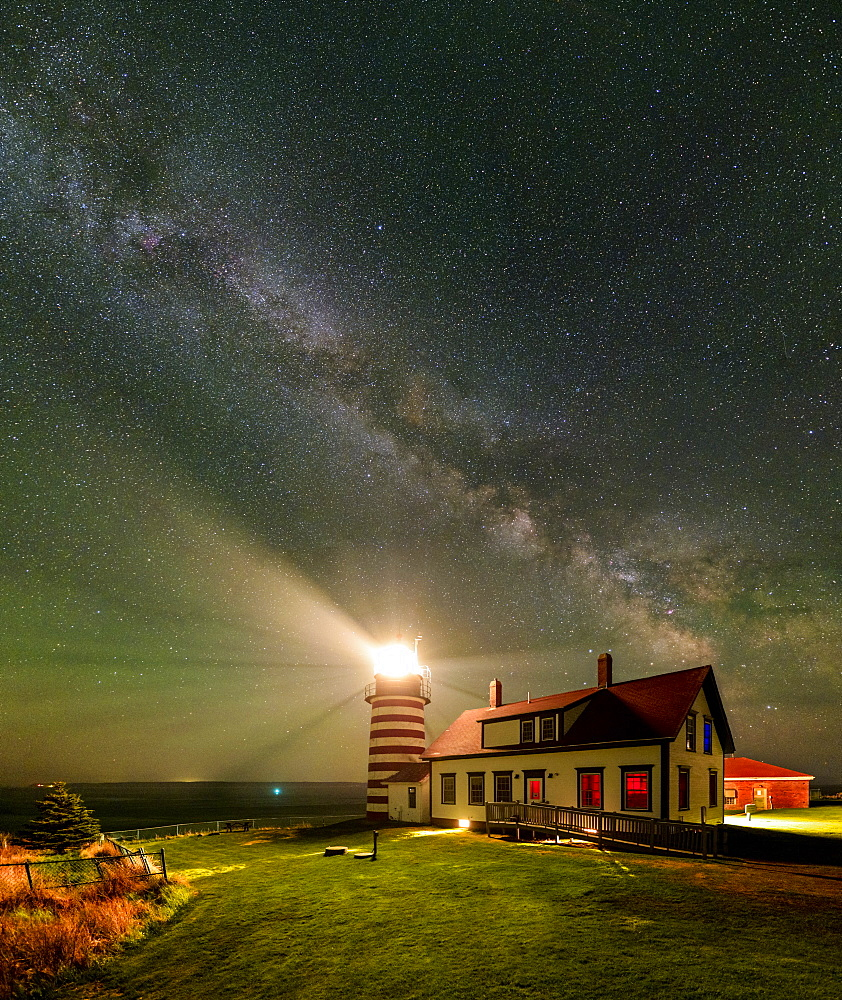 A vertical panorama of the Milky Way over West Quoddy Head Lighthouse in Maine.