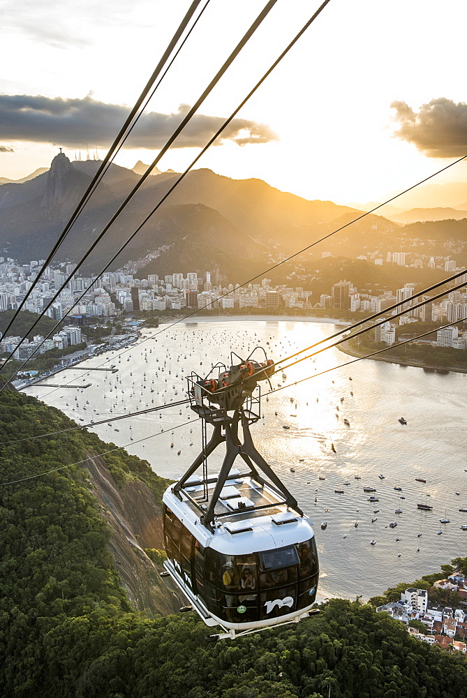 View of Sugar Loaf Mountain cable car with Botafogo Bay during sunset, Rio de Janeiro, Brazil