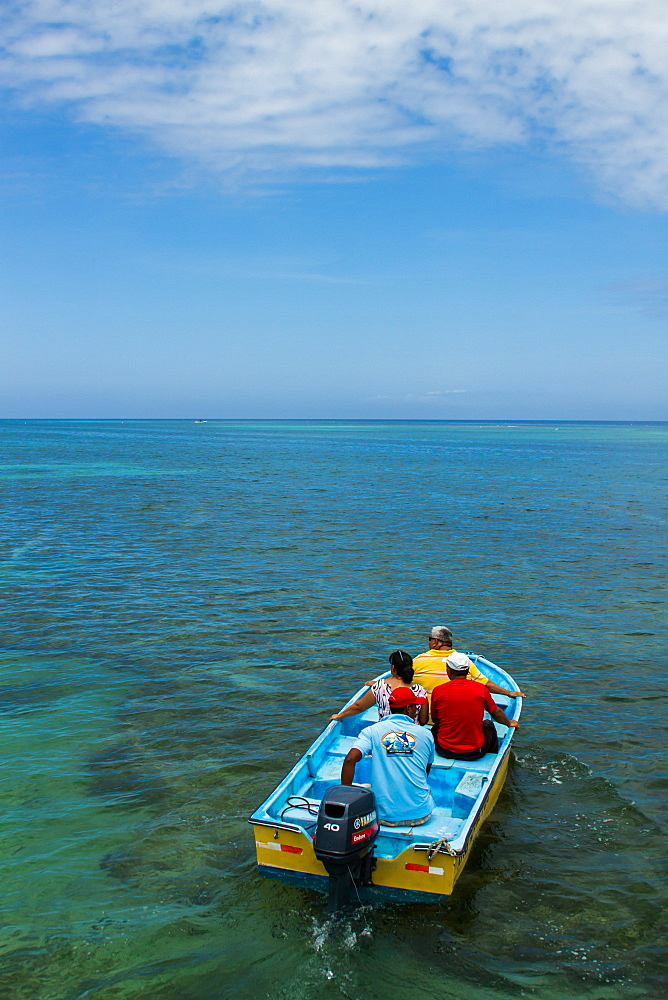 Passengers take a Water taxi from a dock at West End to West Bay Roatan, Honduras.