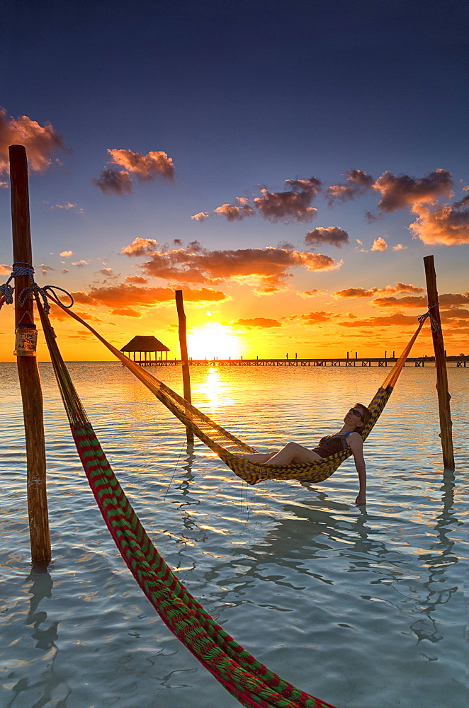 Woman lying in hammock at sunset, Holbox Island, Cancun, Yucatan, Mexico - 857-94965