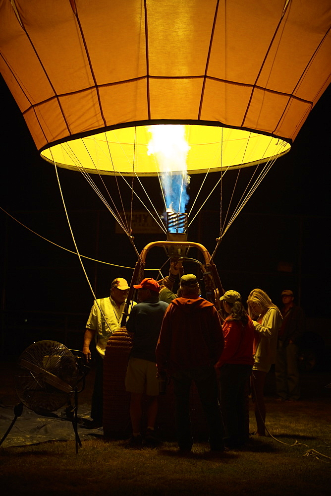 A crew steadies a newly inflated balloon in the morning darkness at the Sonoma County Hot Air Balloon Classic.
