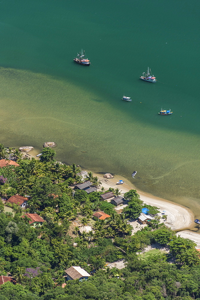 View of fishing village and fishing boats in sea from Mamangua Peak, Saco do Mamangua, Paraty, Costa Verde, Brazil