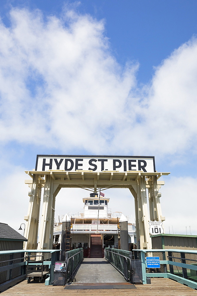 The Hyde Street Pier, at 2905 Hyde Street, is a historic ferry pier located on the northern waterfront of San Francisco, California, amidst the tourist zone of Fishermans Wharf. Prior to the opening of the Golden Gate Bridge and the San Francisco-Oakland Bay Bridge, it was the principal automobile ferry terminal connecting San Francisco with Marin County by way of Sausalito to the north, and the East Bay by way of Berkeley.