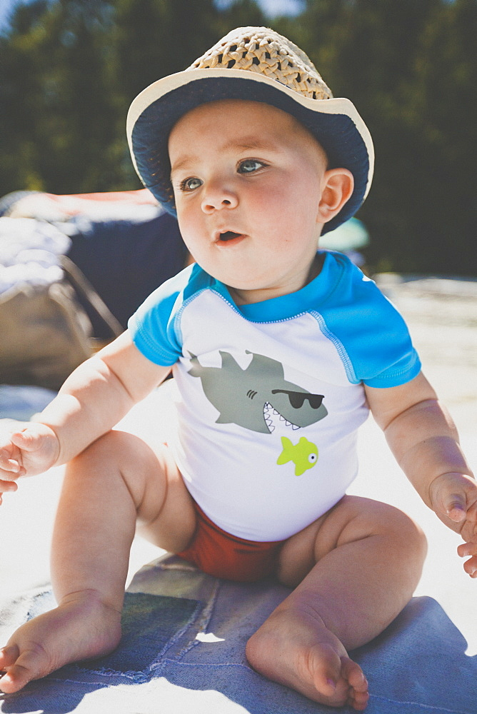 Full length shot of single baby boy sitting at beach