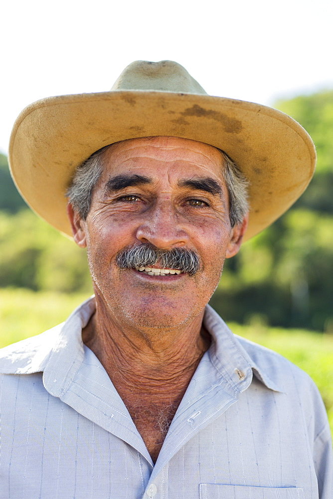 Headshot portrait of smiling farmer in hat, Vinales, Pinar del Rio Province, Cuba