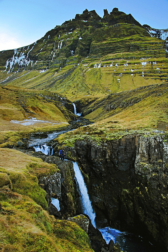 Beautiful natural scenery with waterfall and mountains below Oraefajokull glacier, Iceland - 857-96094