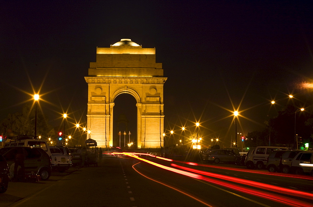 A Road Running Through A Gate At Night; New Delhi India