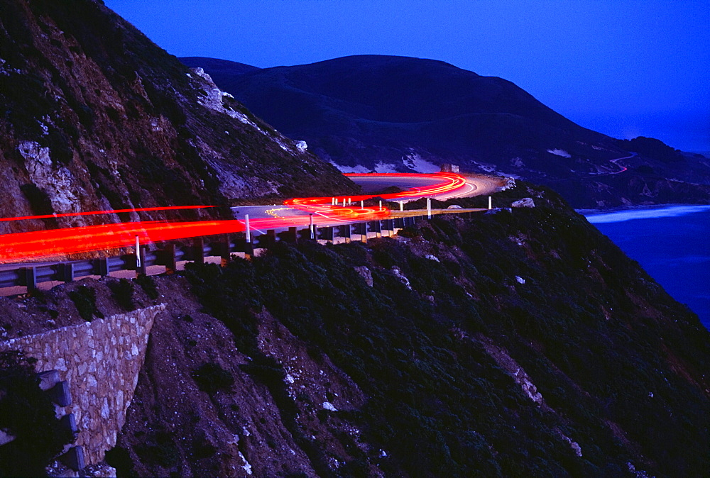 Streaking Car Lights On Mountain Road, California, Usa