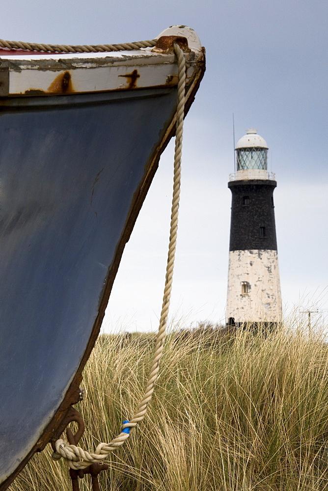 Abandoned Boat And Lighthouse, Humberside, England