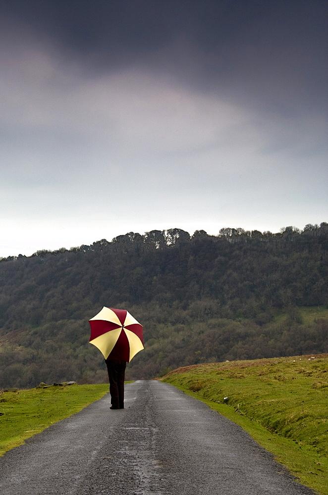 Person With An Umbrella