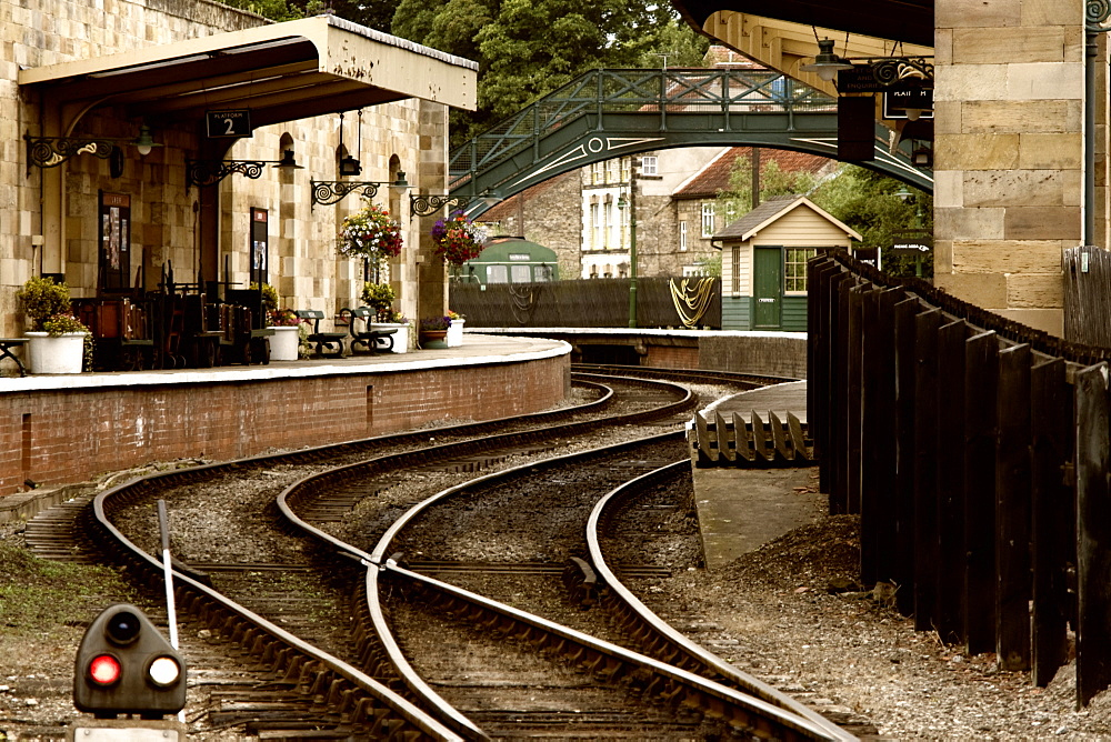An Old-Fashioned Train Station And Tracks