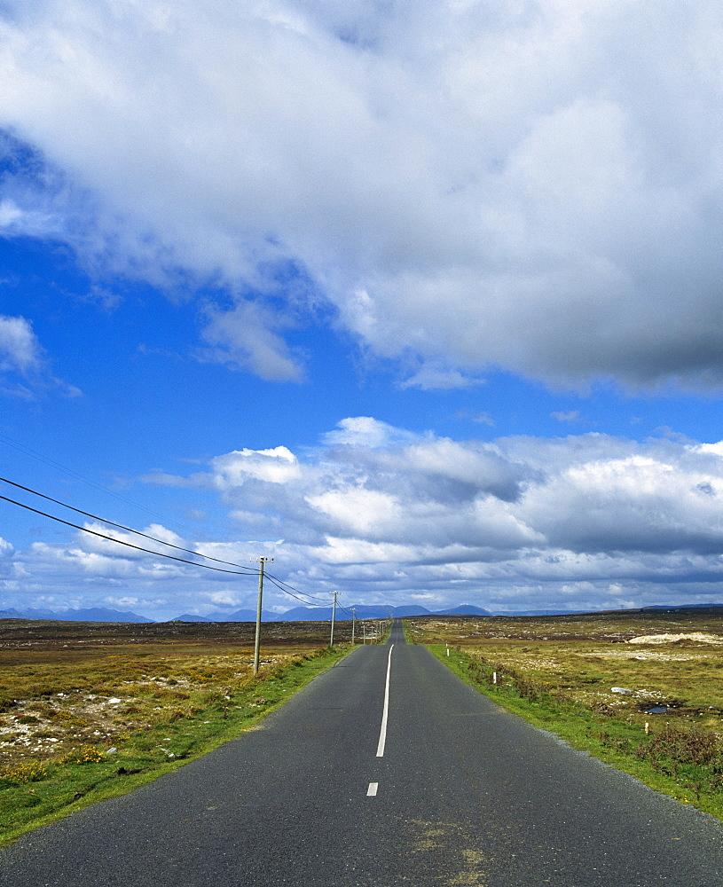 Road Running Through A Bare Landscape, Ireland