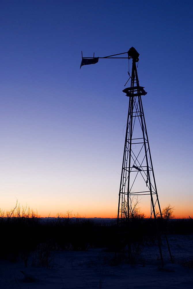 Alberta, Canada, Old Wind Mill At Sunset