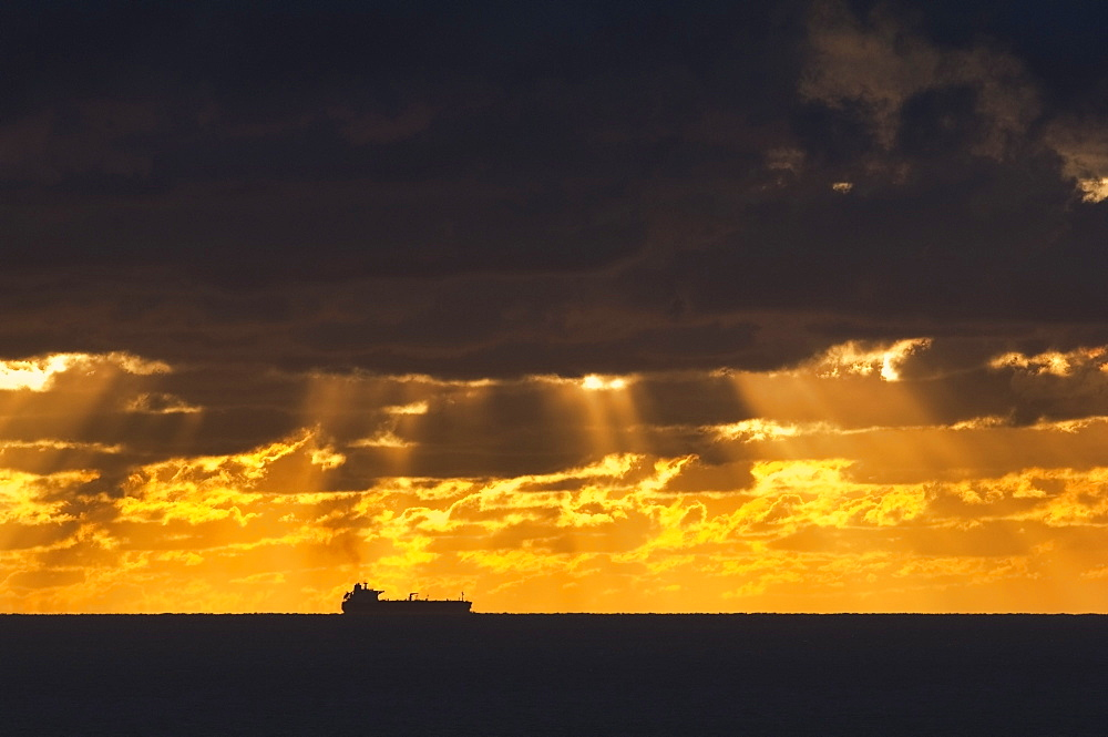 Cargo Ship, Atlantic Ocean, Ship Silhouetted In The Distance In The Ocean