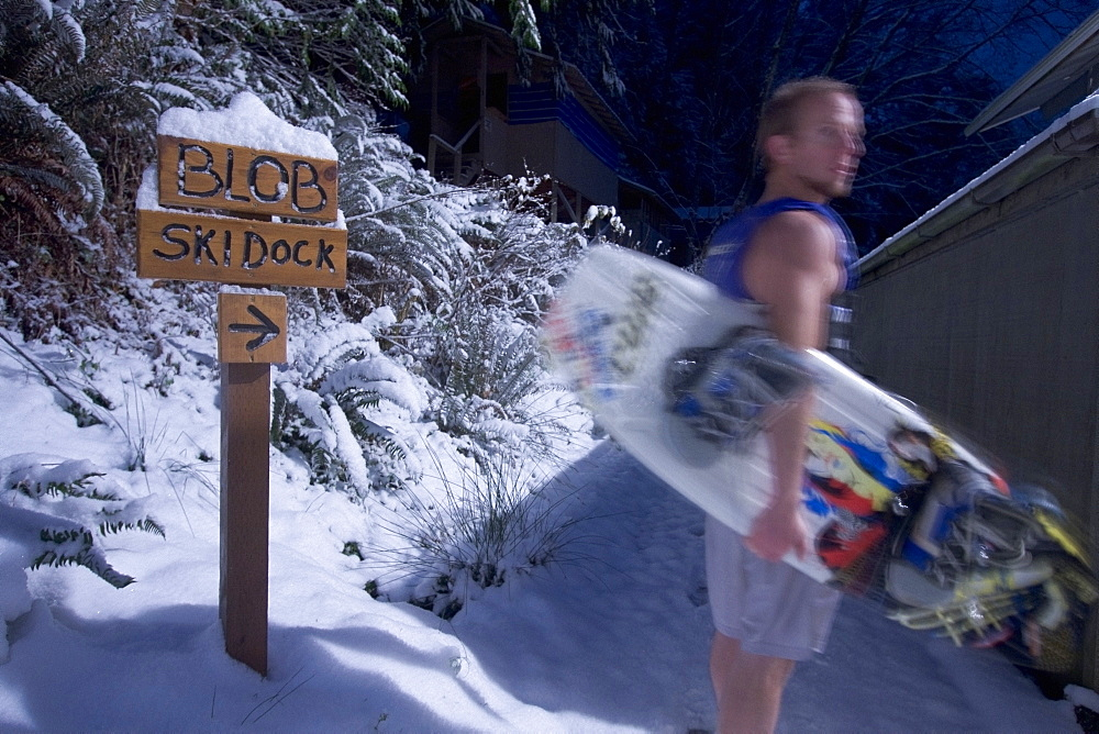 Man Holding A Wakeboard, Wakeboarder In Shorts In The Snow