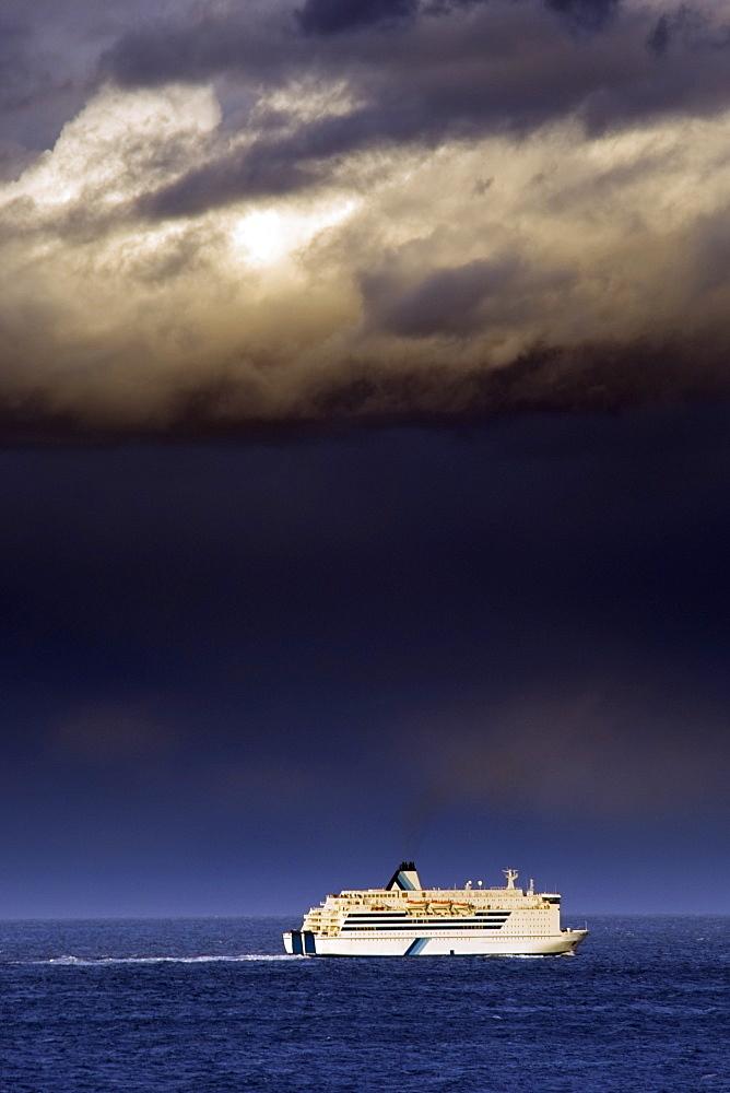 Cruise Ship Under A Dark Cloud