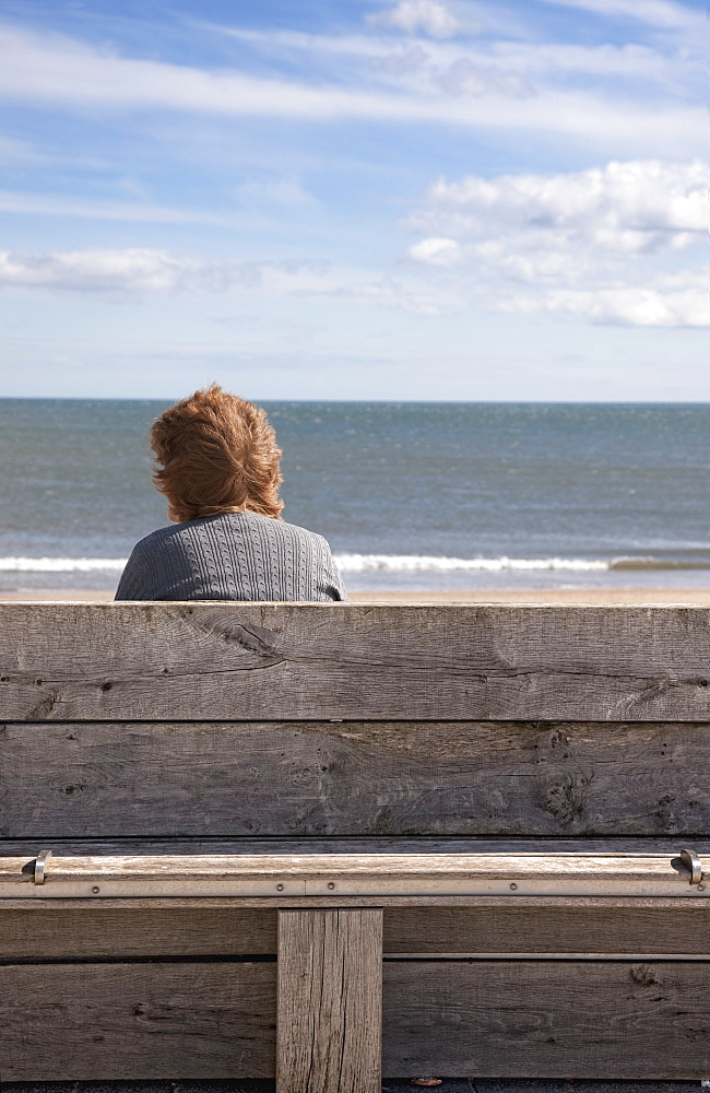 Woman And Water, Woman Sitting On A Bench Looking At A Body Of Water