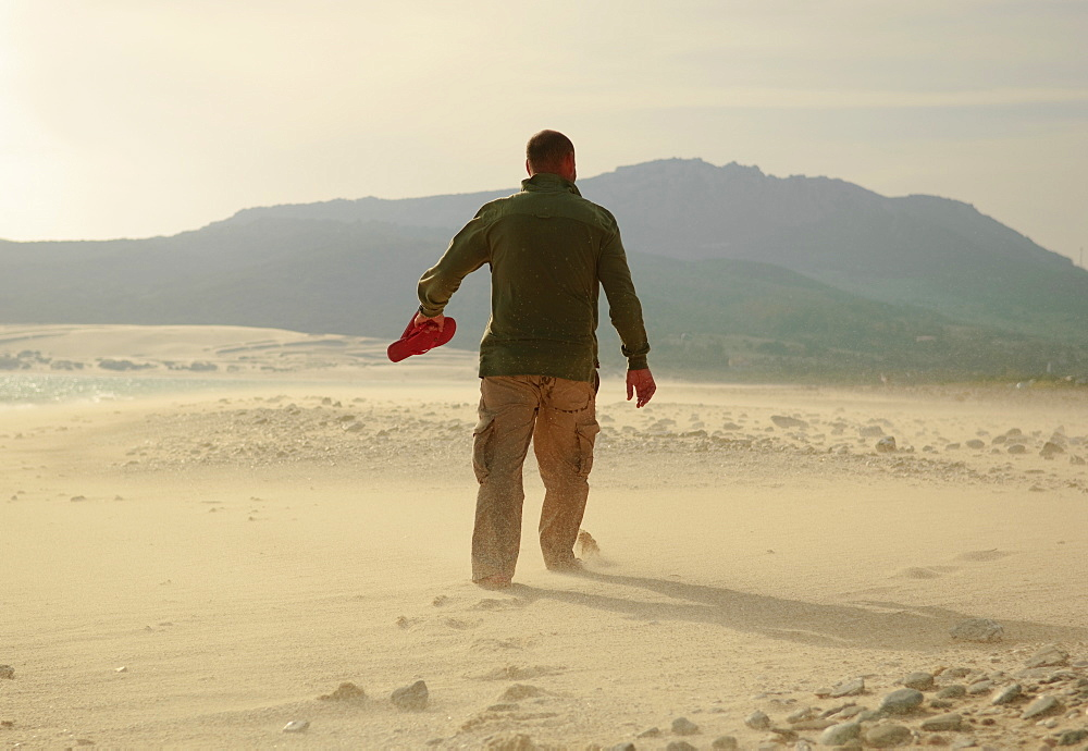 Man Walking On Sand