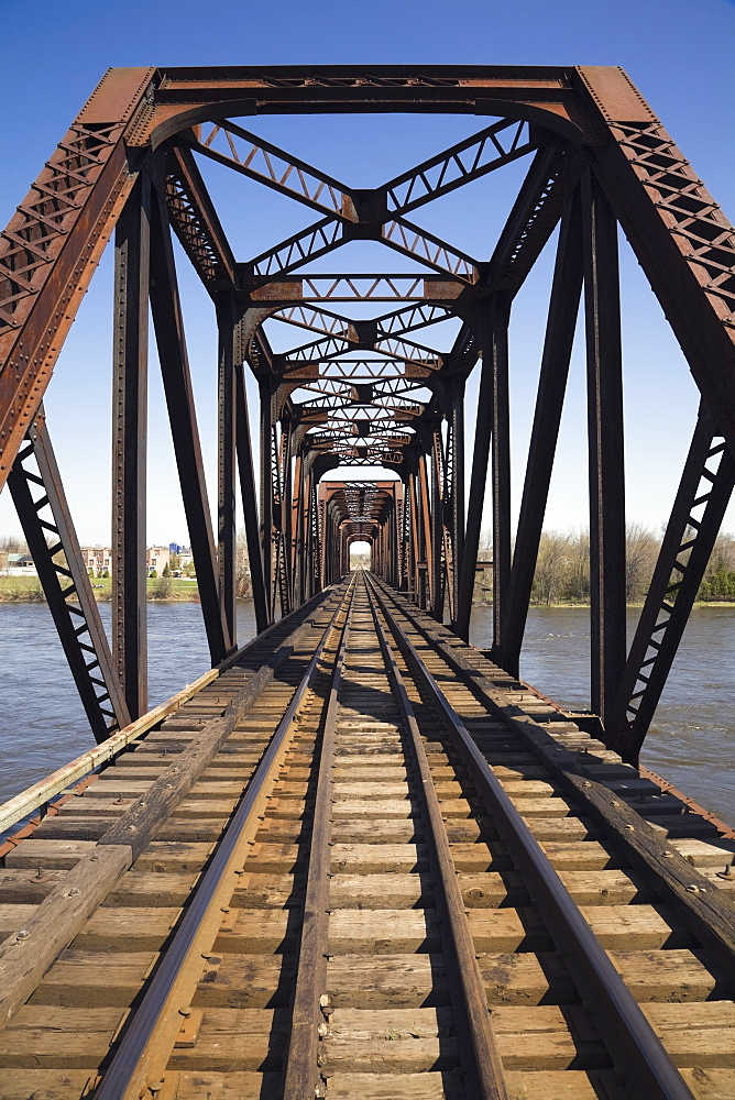 Railroad Tracks Through A Steel Railroad Bridge, Laval, Quebec, Canada