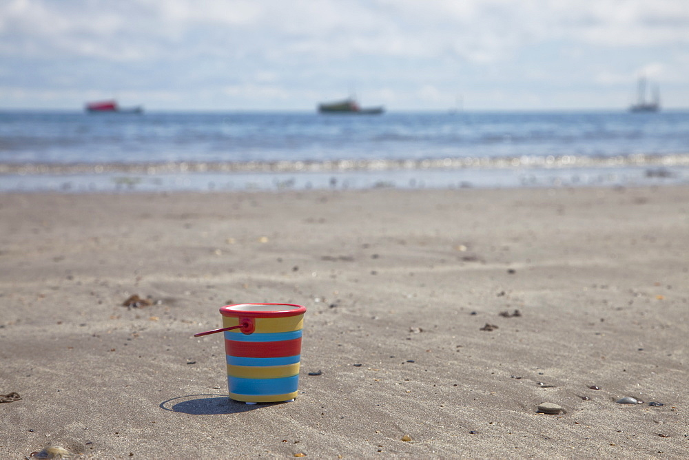 Bucket On The Beach, Northumberland, England