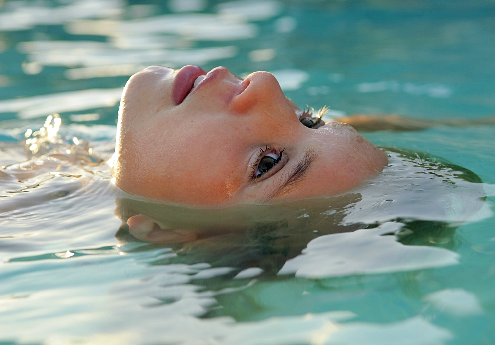 Girl Floating In The Water
