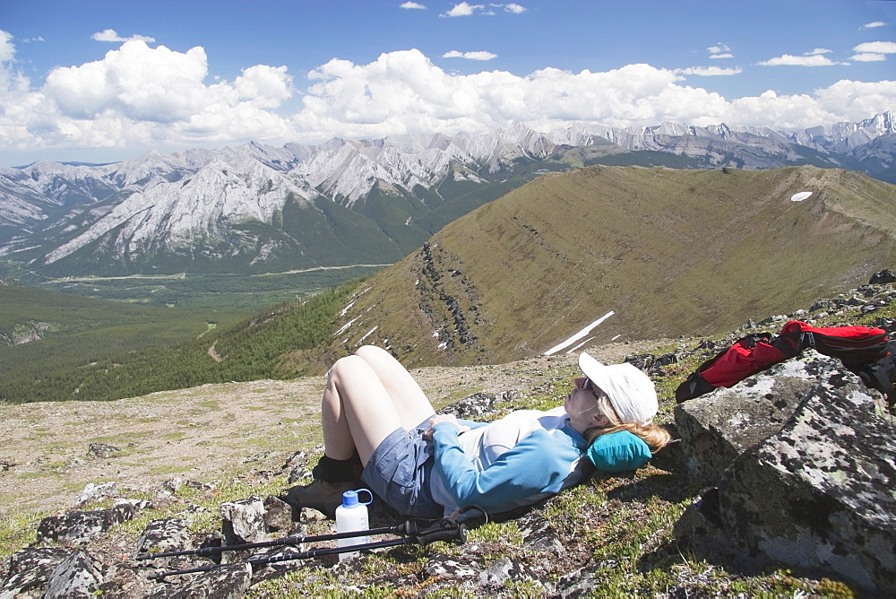 Woman Hiker Resting On A Mountain Top