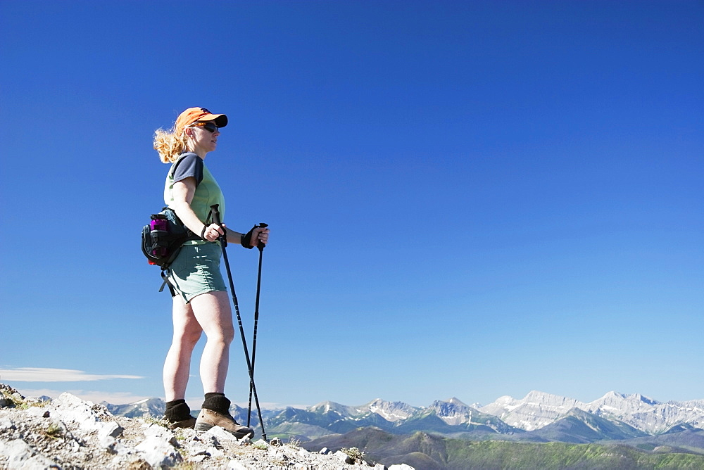 Woman Hiking On A Mountain Top And Enjoying The View
