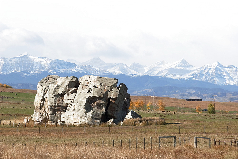 Big Rock And Mountains, Alberta, Canada