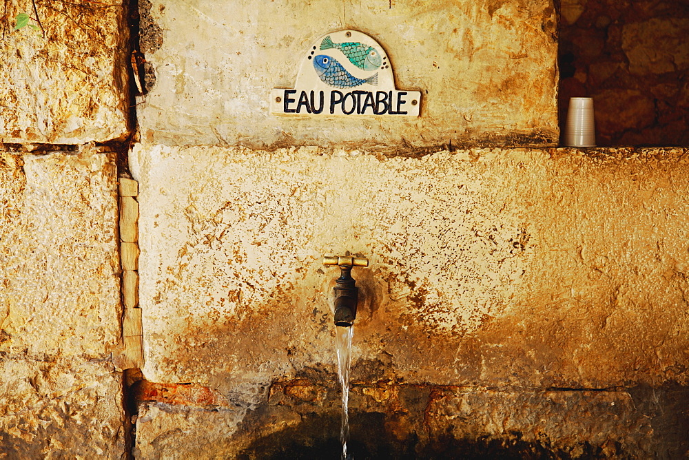 Gourdon, Provence, France, Water Tap With A Sign Saying 'eau Potable'