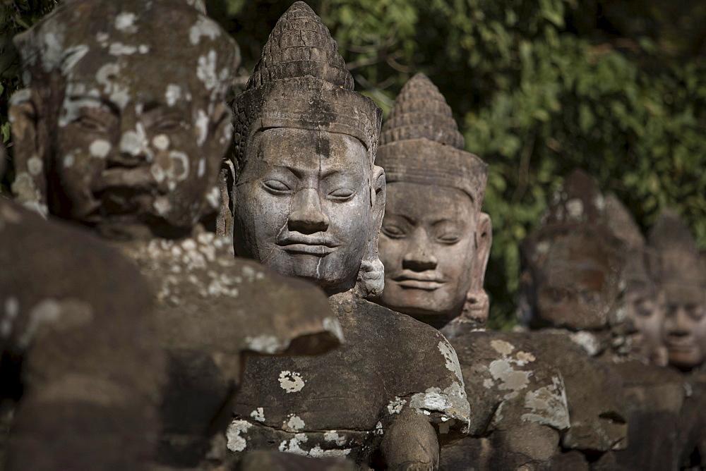 Statues Lining Main Gates Of Ancient City, Angkor Wat, Cambodia