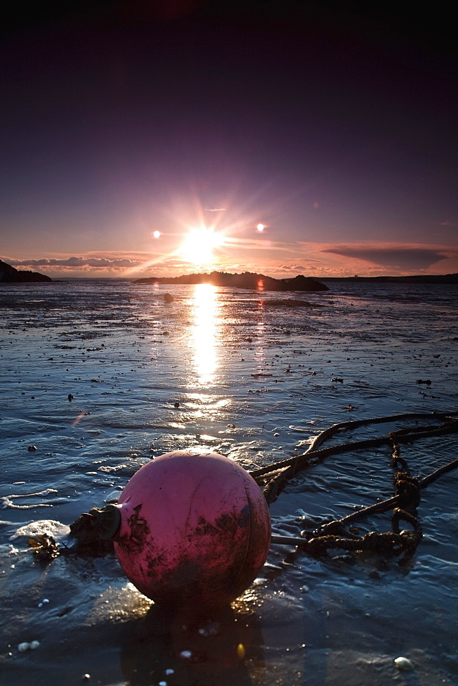 Dumfries, Scotland, A Rope Tied To A Buoy Laying In The Tide On The Shore At Sunset