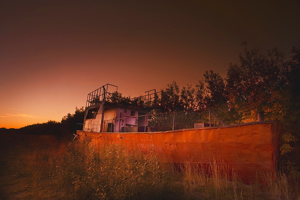 Inuvik, Northwest Territories, Canada, An Abandoned Ship On The Riverbank