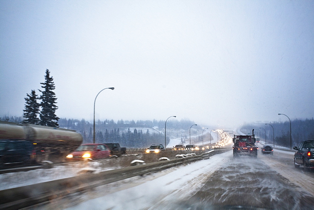 Edmonton, Alberta, Canada, Vehicles Traveling On The Road With Snow Blowing In Winter