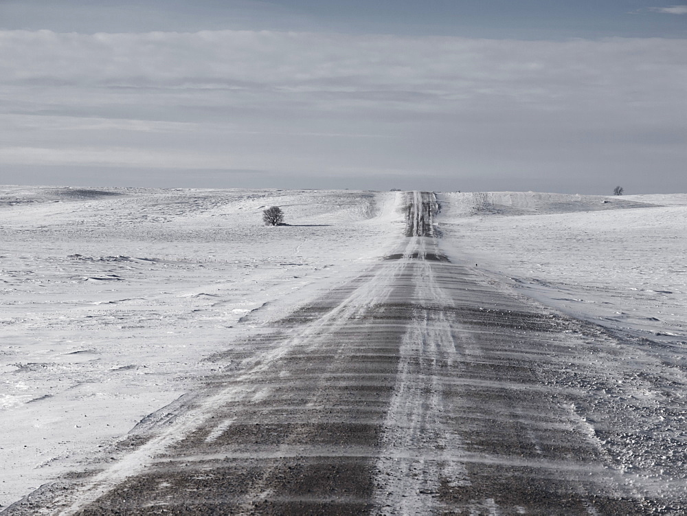 Morden, Manitoba, Canada, Snow Blowing Over A Gravel Road In Southern Manitoba