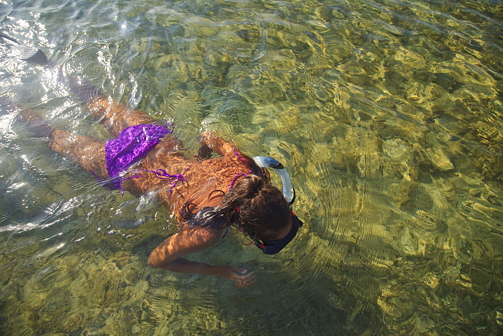 Roatan, Bay Islands, Honduras, A Young Woman Snorkeling At Anthony's Key Resort