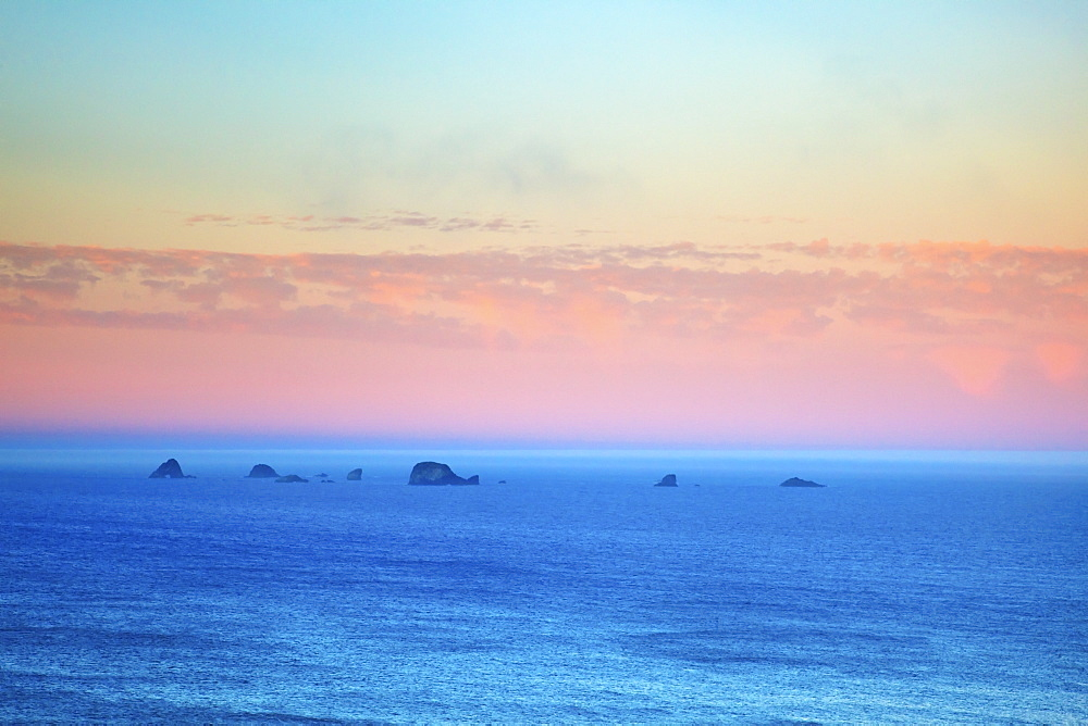 Sunrise Over Rock Formations At Cape Blanco, Oregon United States Of America