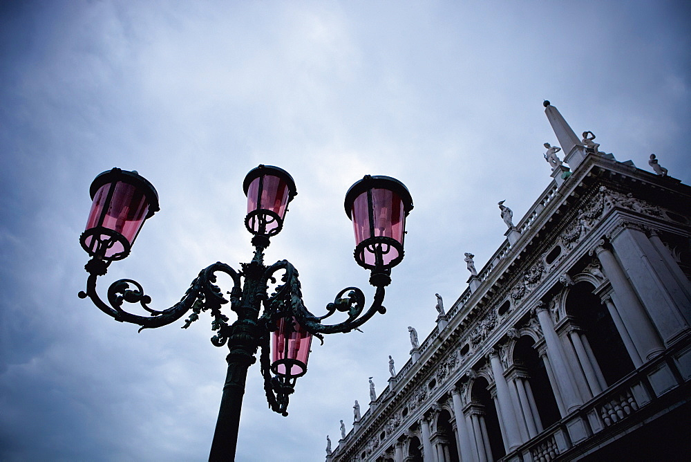 A Light Standard And An Ornate Building With Sculptures Lining The Roof, Venice, Venezia, Italy
