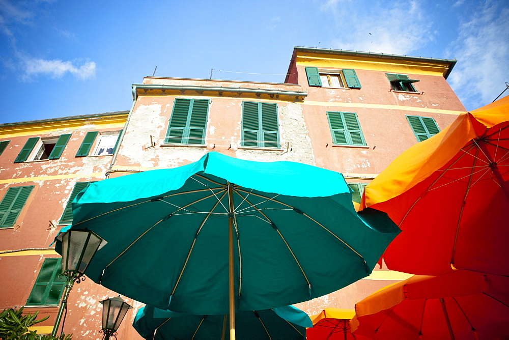 Green And Yellow Patio Umbrellas Beside A Building, Vernazza, Liguria, Italy