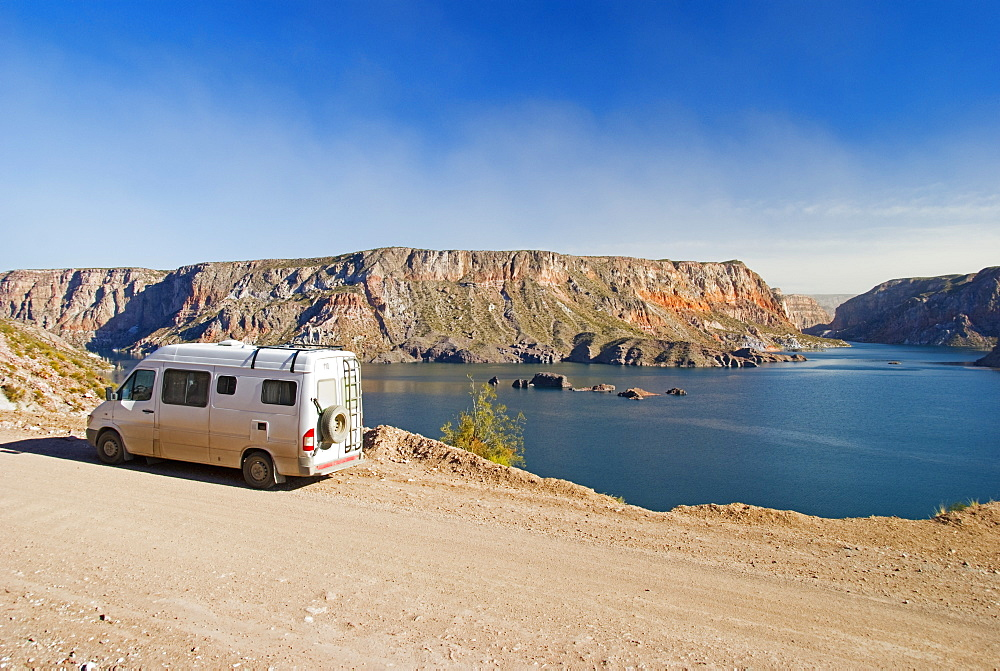 A Camper Van Parked Beside The Lake In Ca?on Del Atuel, San Rafael, Mendoza, Argentina