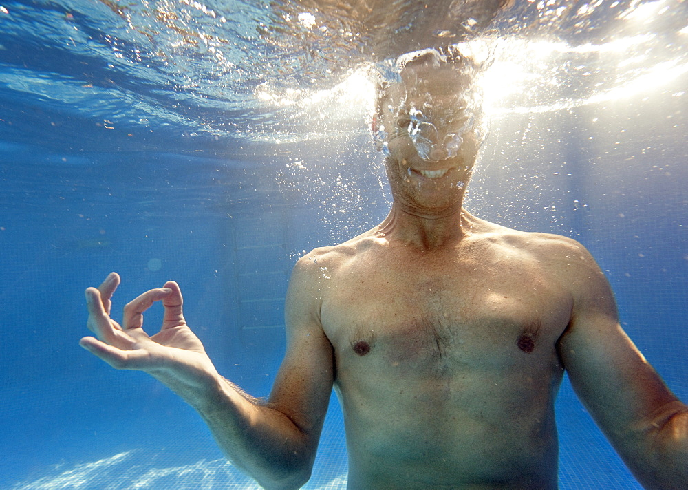 A Man Doing A Mediation Pose Under The Water, Benalmadena Costa, Malaga, Andalusia, Spain - 1116-41479