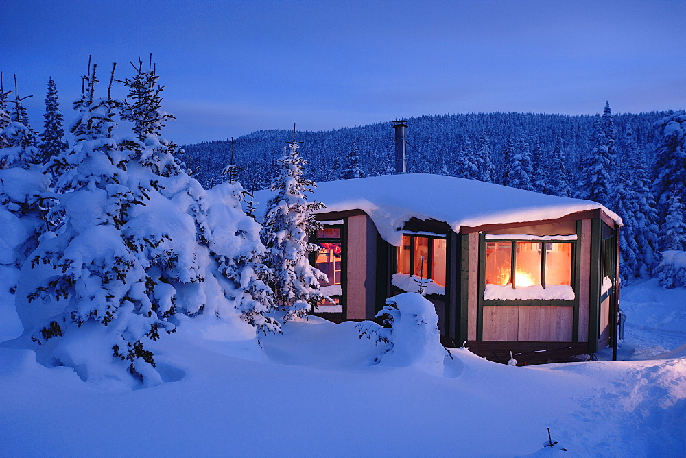View Of La Mesange Shelter And Snow-Covered Trees At Twilight, Quebec, Canada