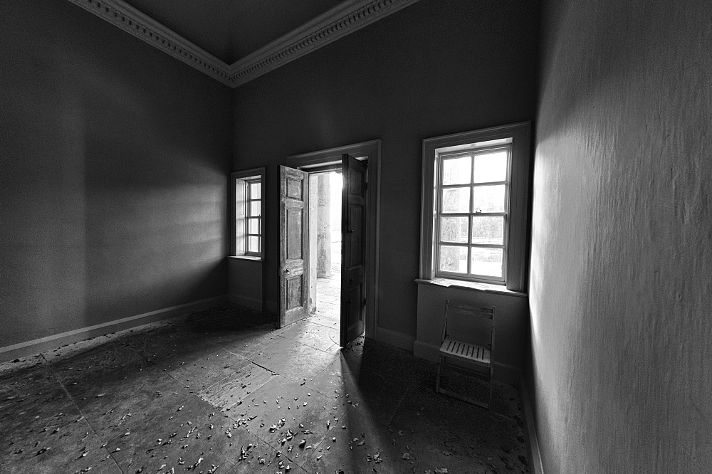 Light Shining Into A Dark Room Through An Open Door, North Yorkshire, England