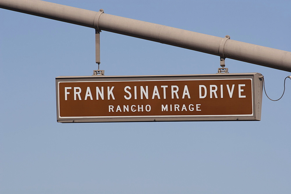 Close Up Of Frank Sinatra Drive Road Sign Against A Blue Sky, Rancho Mirage, California, United States Of America