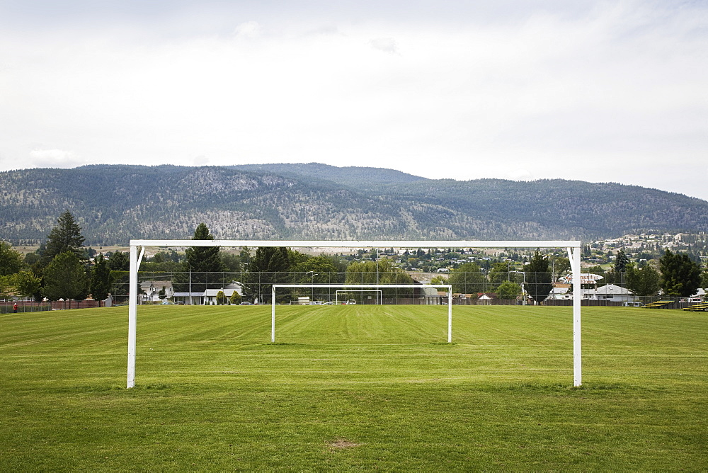 Goal posts in a row in a grass recreation field, British columbia canada