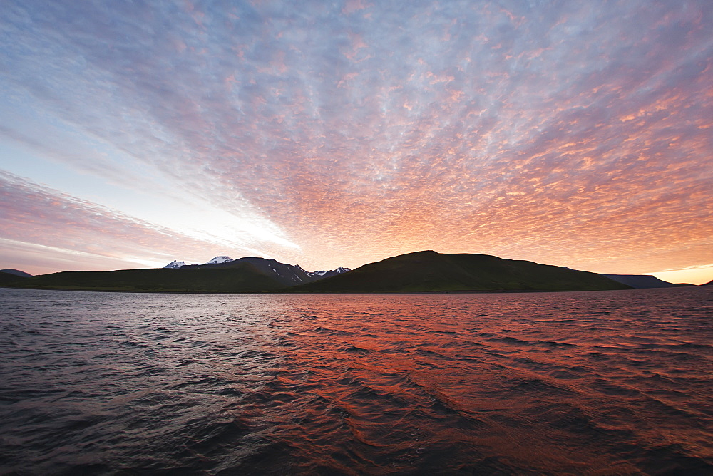 Sunset Behind A Ridgeline From The Water Near Cold Bay, Southwest Alaska, United States Of America